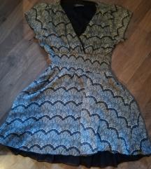 Leprsava krem haljina sa tamno braon postavom