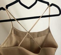 Krem haljina gola ledja