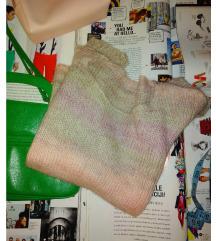 Rupičasti džemper pastelnih boja