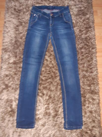 Zenske teksas pantalone velicina:31
