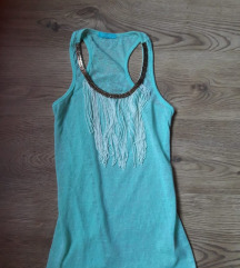 Svetlo plava majica sa resama
