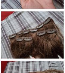 Jos jedna kosa na klipse prirodna