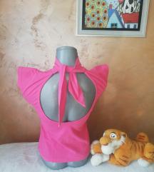 Roze rolkica gola leđa