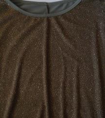 Zanimljiva bluzica, napred diskretno svetlucava