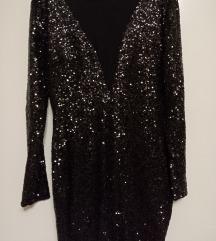 Šljokičava crna haljina